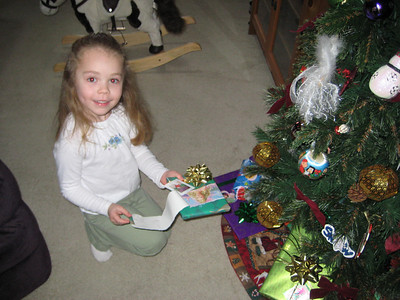 Finding her gifts under the tree.
