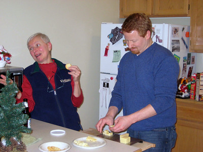 Mother and Son cut the cheese. Get it? :)
