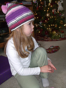 She looks angry here, but she wasn't at all.  She was just intently watching Whitney open her gift.