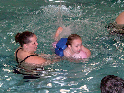 She loved swimming with the floaties on! Swim lessons - week 6 (final class)