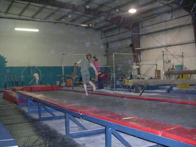 1.14.2009 - Kimber's 1st gymnastics class. Jumping along the long trampoline.