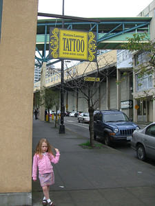 May 2009 - Whitney's 2nd session for her John Waterhouse tattoo.  Kimber hanging out under the sign.