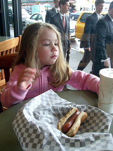 May 2009 - Kimber and I eating hotdogs in Pike Place Market during Whitney's 2nd session for her John Waterhouse tattoo.
