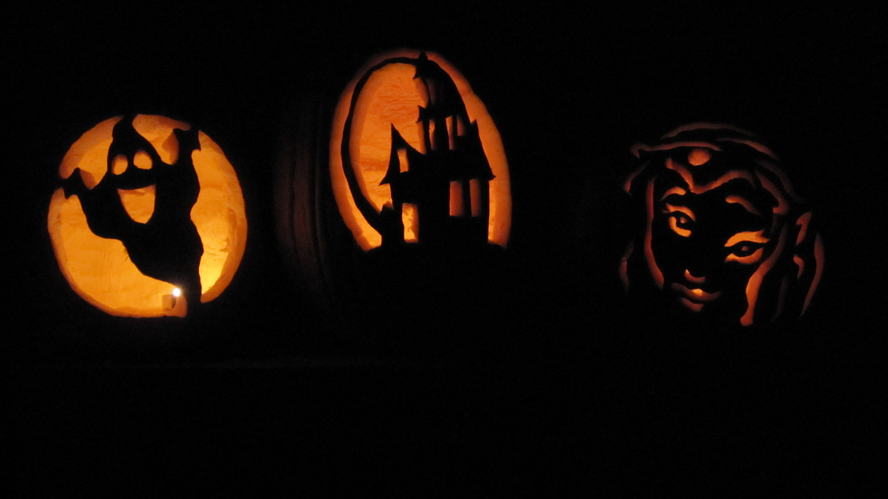Halloween '09 - Carving pumpkins. From left to right, Whitney's, Tod's and Kimber's.