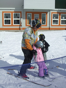 2.21.2009 - Kimber's 2nd ski lesson at Stevens Pass. Getting pushed over to the traction-mat by the coach.