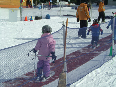 2.21.2009 - Kimber's 2nd ski lesson at Stevens Pass. Walking up the traction mat so she can take a turn going down the small hill.