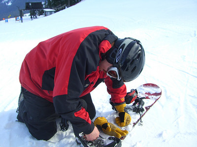 2.21.2009 - Tightening up his bindings at Stevens Pass.