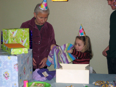 Opening presents (this one's from Grandmama Carol & Papa Ben).
