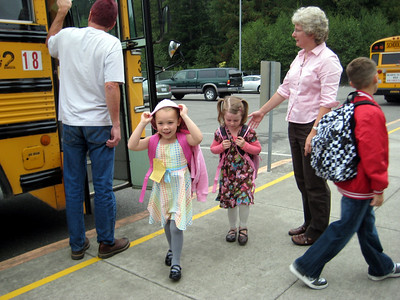 9.10.2009 - First day of kindergarten. Getting off the morning bus at school (yes, we met her at school).