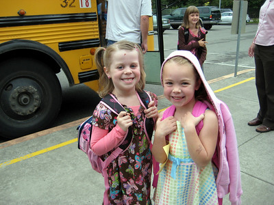9.10.2009 - First day of kindergarten. A friend she met on the bus.