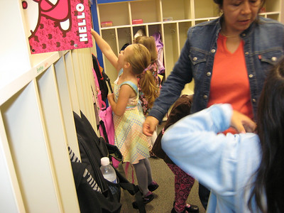 9.10.2009 - First day of kindergarten. Hanging up her backpack and jacket.