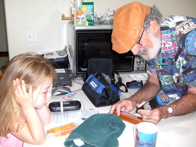 """Carving """"smart"""" into the train whistle he made for her last year because she can spell """"smart"""" now (June '09)."""