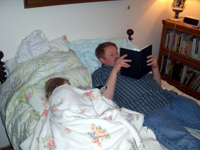March 2009 - Visiting Grandma in Illinois. Kimber taking a nap while uncle Chad reads.