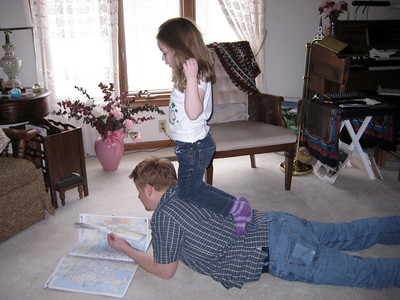 March 2009 - Visiting Grandma in Illinois. Kimber uses uncle Chad as a balance beam...surprisingly this is before she started gymnastics.