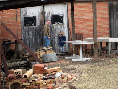March 2009 - Visiting Grandma in Illinois; at the brickyard where Dad worked as a teenager. Kimber and I peeking in to the warehouse where the stuff was kept. It has most recently been used as an art studio; we could see all kinds of metal-type art stuff.
