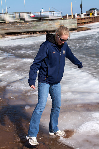 Sara standing on the ice.