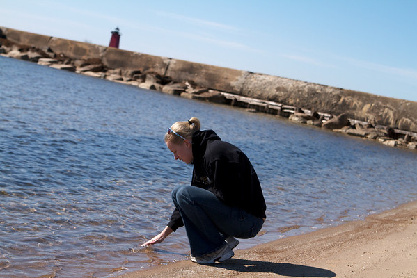 Sara checking the water temperature in Manistique, MI