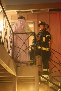 Firefighter talking to Lee