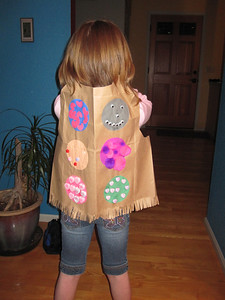Mar '11 - Proudly displaying her 100-day (days of school) vest they made in 1st grade. They got to parade around the school.