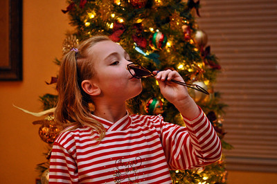 A pretend drink from the wine glass ornament