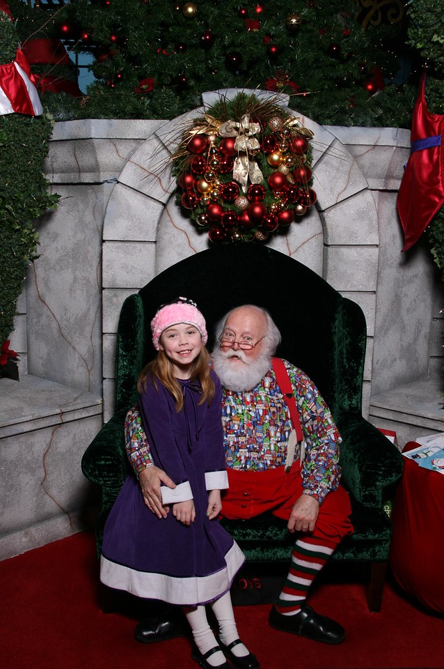 Kimber's picture with Santa, wearing her annual Christmas dress from Grandma Carol.