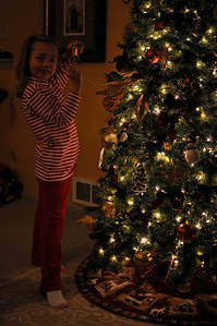 Holding the high heel ornament while wearing new clothes from Grandma Carol