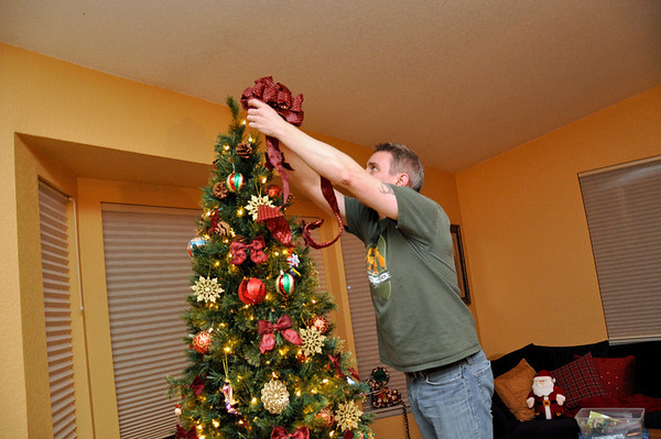 Nov '11 - Decorating the Christmas tree - here goes the bow on the top!