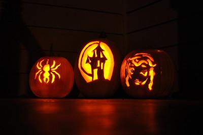 2011.10 - Carved pumpkins...Whitney's, mine & Kimber's.