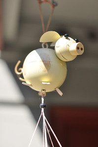 A piggy wind-chime on our back porch.