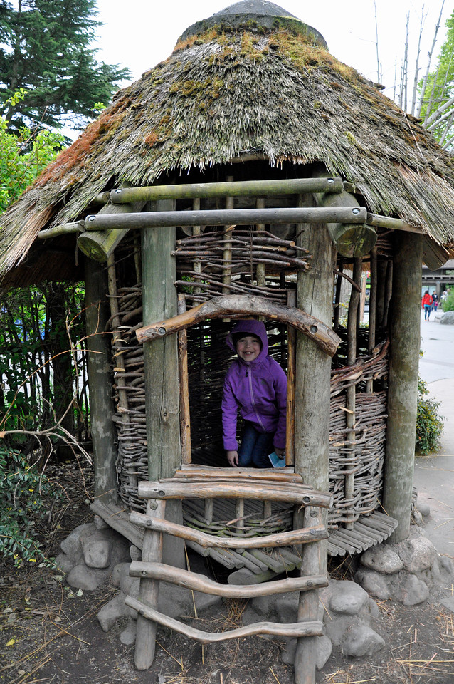 2012.04 - Zoo. Kimber in a hut from the African safari exhibit.