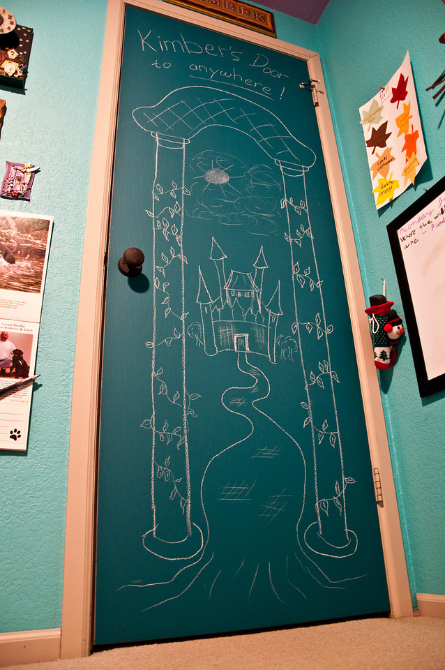 2012.08 - Kimber's bedroom door is now a chalkboard canvas (with the initial drawing from Dad)