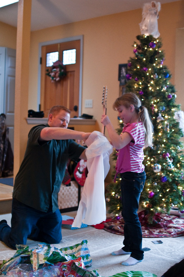2012 Christmas - uncle Chad giving Kimber her electric guitar