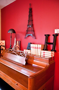 2012.06 - Ivory's birthday: wine tasting in Walla Walla. Red wall behind the Eiffel tower on a piano.