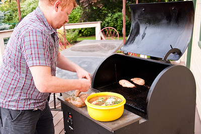 2012.06 - Ivory's birthday: wine tasting in Walla Walla. Chad loading up the Traeger with huge chicken breasts.