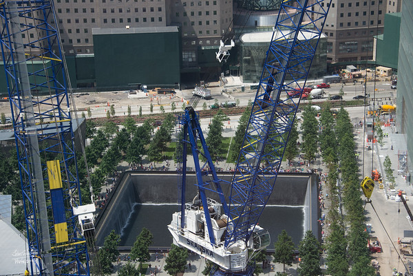 Closer view of the North Tower site and a memorial pool over the footprint of the tower.
