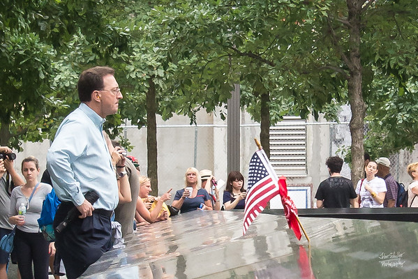 A man stares into the pool - frustration, anger, deep sadness, helplessness - even a bit defiant, just as the US flag protrudes out from someone's name - equally defiant.