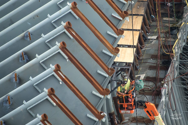 Welders at work assembling infrastructure of the transportation center.
