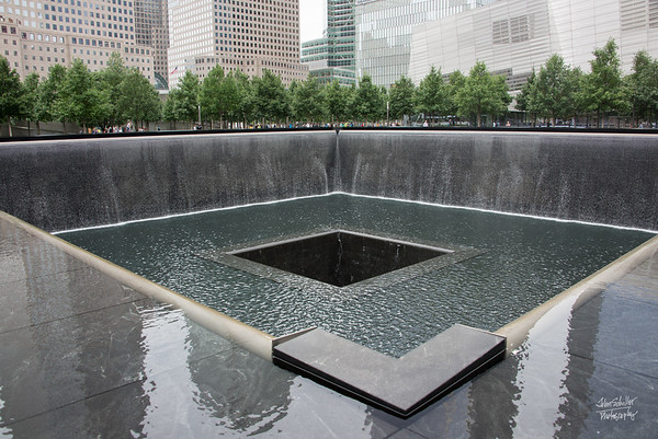 In the center of the South Tower pool, a deep, black abyss.