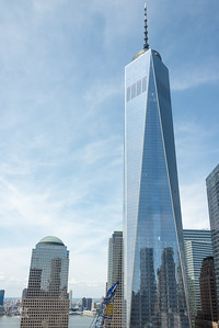 One World Trade Center - the tallest building now in the western hemisphere rises above the site of the former North and South Towers of the World Trade Center.