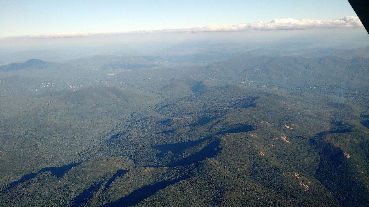 I've always wanted to fly over the White Mountains; its an amazing place. So when a quiet friday evening lined up with when I had the plane and two friends who felt likewise we went for it. This is looking south at Attitash from over the Dry River Wilderness.