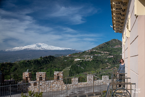From teh balcony of our room, Nancy is in the next room and all in sight of Mt. Etna