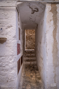 Narrow pathway in historic Polignano
