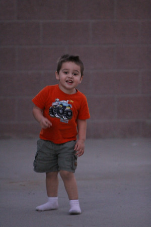 March 16  My smily boy playing outside without shoes.