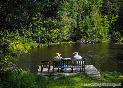 Flyfishing friends chat along the river. 6-23, 8:48 a.m.