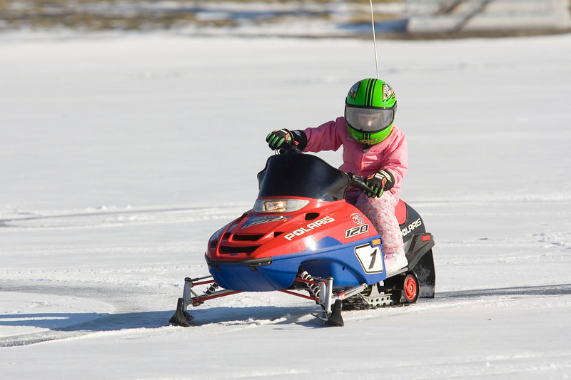 Playing on a frozen lake and going snow mobiling outside of Angola Indiana.  PHOTO BY ALEX TURCO