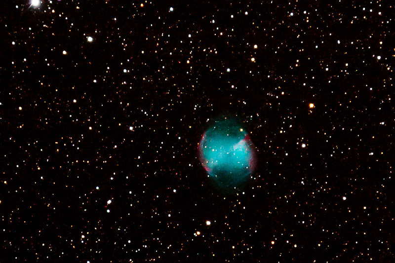 M27.  The Dumbbell Planetary Nebula.   815 LY.   It was caused when a blue dwarf star exploded 48,000 years ago & is now 1.2 LY in diameter
