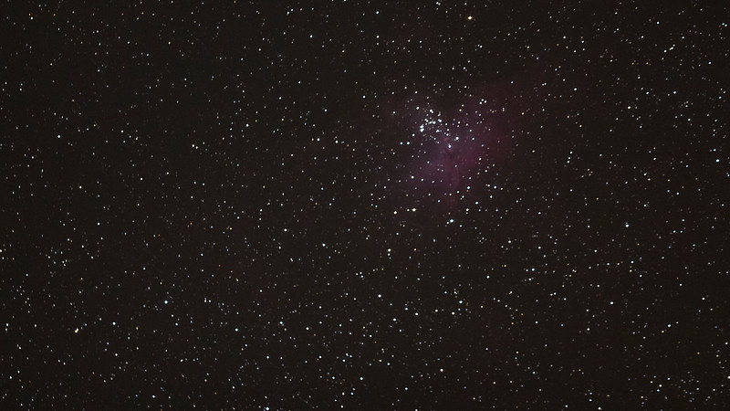 "The Eagle Nebula (catalogued as Messier 16 or M16, and as NGC 6611, and also known as the Star Queen Nebula and The Spire) is a young open cluster of stars in the constellation Serpens, discovered by Jean-Philippe de Chéseaux in 1745–46. Both the ""Eagle"" and the ""Star Queen"" refer to visual impressions of the dark silhouette near the center of the nebula,[2][3] an area made famous as the ""Pillars of Creation"" photographed by the Hubble Space Telescope. The nebula contains several active star-forming gas and dust regions, including the Pillars of Creation."