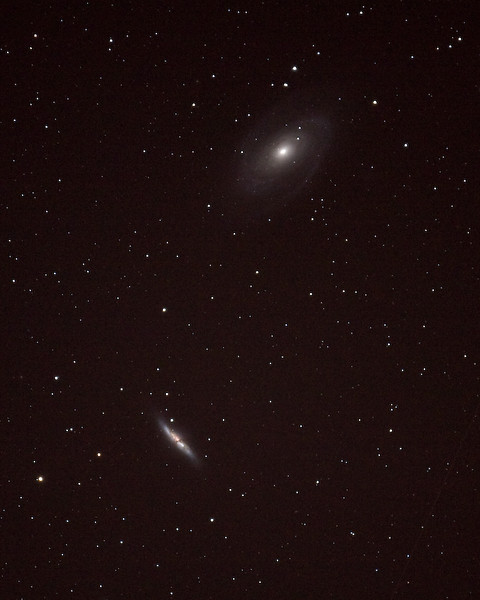 2 Galaxies near the Big Dipper.  Spiral Galaxy, Messier 81 (at the top ) is 4,500,000 light-years away.   Messier 82 (at the bottom) is an Irregular Galaxy that is 17,000,000 light-years distant.