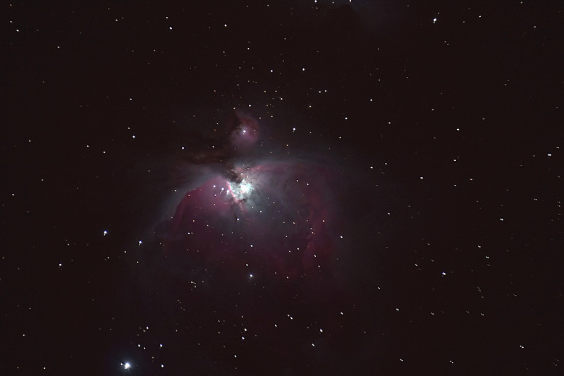 The Great Orion Nebula.   This Emission Nebula & Cluster is also known as Messier 42.   It is 1,500 light-years from Earth.  The bright area is where thousands of stars are being born.