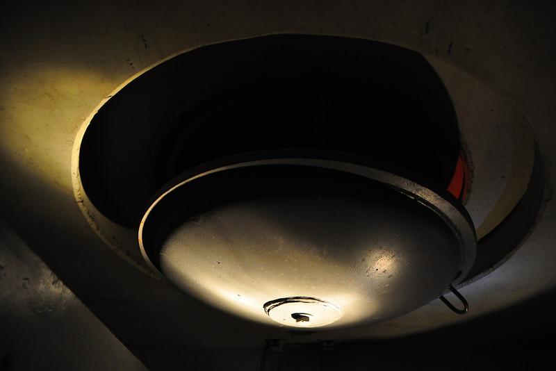 ventilation shaft lit by flashlight.